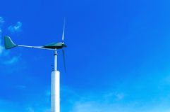 Wind turbine. On cloudy blue sky background Royalty Free Stock Photo