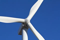 Wind turbine. Close shot of a wind turbine on a clear blue sky Royalty Free Stock Photo