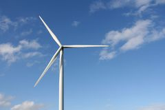 Wind turbine. S in a field, in summer, over a blue sky Royalty Free Stock Photography