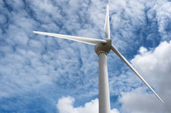 Wind turbine. Single windmill against cloudy sky Royalty Free Stock Photography