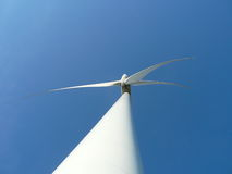 Wind turbine. Over the blue sky Stock Photography