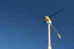 Wind turbine. With motion blur, against blue sky Royalty Free Stock Image