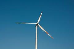 Wind turbine. Against blue sky, power generation Royalty Free Stock Image