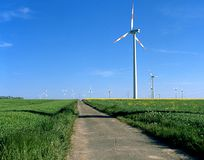 Wind turbine. The picture shows a green flat landscape with wind turbines royalty free stock photography