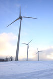 Wind turbine. Three power generating wind turbines in winter Royalty Free Stock Photos