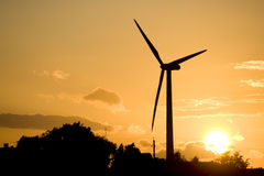 Wind turbine. A wind turbine at sunset royalty free stock photos
