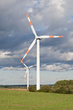 Wind turbine across Stock Image