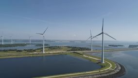 Wind turbine from aerial view, Drone view at windpark krammersluizen a windmill farm in the lake grevelingen in the Netherlands, stock footage