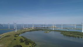 Wind turbine from aerial view, Drone view at windpark krammersluizen a windmill farm in the lake grevelingen in the Netherlands, stock video footage