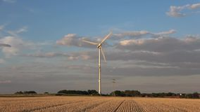 Wind turbine against the background of the evening sky. Alternative energy Ecological problems wind turbines in the field stock video