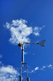 Wind Turbine Against a Blue Sky Stock Image