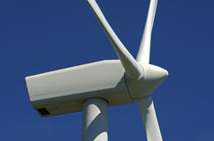 Wind turbine against blue sky Royalty Free Stock Images
