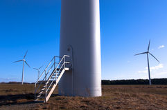 Wind turbine against blue sky Stock Photos
