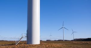 Wind turbine against blue sky Royalty Free Stock Photography
