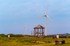 Wind turbine against the blue sky Royalty Free Stock Photography