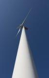 Wind Turbine. A wind turbine against blue sky background Royalty Free Stock Image