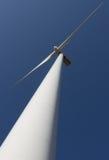 WIND TURBINE. A wind turbine against blue sky background Stock Photo