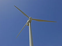 Wind turbine against blue sky. These turbines are used to produce renewable and clean energy in the energy ecological farms Stock Photos