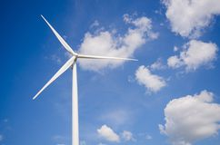 Wind turbine against cloudy sky Royalty Free Stock Images