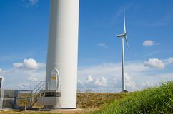 Wind turbine against cloudy sky Stock Photography