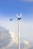 Wind turbine against partly Royalty Free Stock Photos