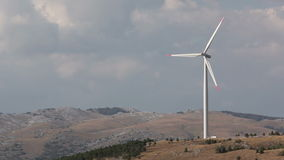 Wind turbine. Against sky with clouds. Mediterranean landscape stock video