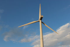 Wind turbine against the sky stock images