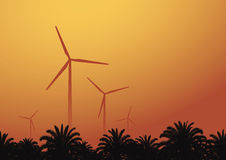 Wind turbine against the sunset background Stock Photography