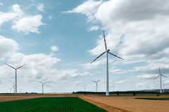 Wind turbine on agricultural field Royalty Free Stock Photos