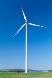 Wind turbine, alternative energy. Wind turbine farm, alternative energy on green field stock image