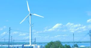 Wind Turbine for alternative energy on background sky. stock video footage