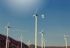Wind Turbine for alternative energy, on background Sky Stock Photo