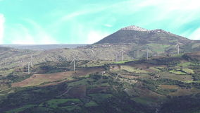 Wind turbine alternative renewable energy with small town in background stock video