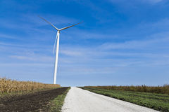 Wind turbine amongst the farms Royalty Free Stock Photos