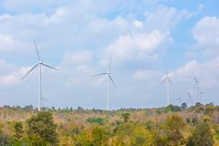 Wind turbine with autumn color leaves Royalty Free Stock Photography