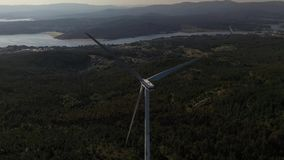 Wind turbine on the background of a beautiful landscape aero video. 4k slow motion stock video footage