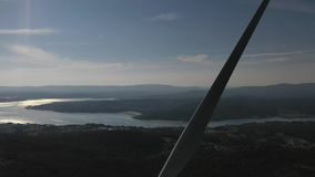 Wind turbine on the background of a beautiful landscape aero video. 4k slow motion stock video