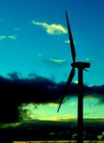 Wind turbine backlit  at dawn Stock Photo