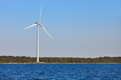 Wind turbine in the baltic sea. Renewable green energy. Finland Stock Photography