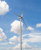 The wind turbine in beautiful cloudy blue sky background, concep Royalty Free Stock Image