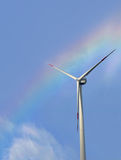 Wind turbine on beautiful rainbow sky. Stock Image