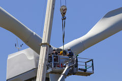 Wind turbine being repaired. Assisted by crane and elevator stock images