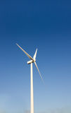 Wind turbine blades against blue sky Stock Photography