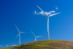 Wind turbine with 3 blades in a field of grass Stock Photography