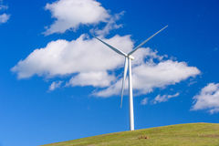 Wind turbine with 3 blades in a field of grass Royalty Free Stock Photo