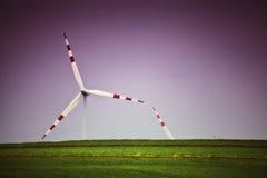 Wind turbine bliss alternative. An alternative desktop backround with bliss theme, wind turbine generator on a green field with purple pink skies Stock Photography