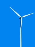 Wind turbine on blue background Stock Photos