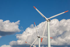 Wind turbine. Blue clouded sky Royalty Free Stock Photos