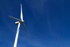 Wind turbine on blue sky Stock Photos