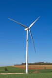 Wind turbine on blue sky Stock Image